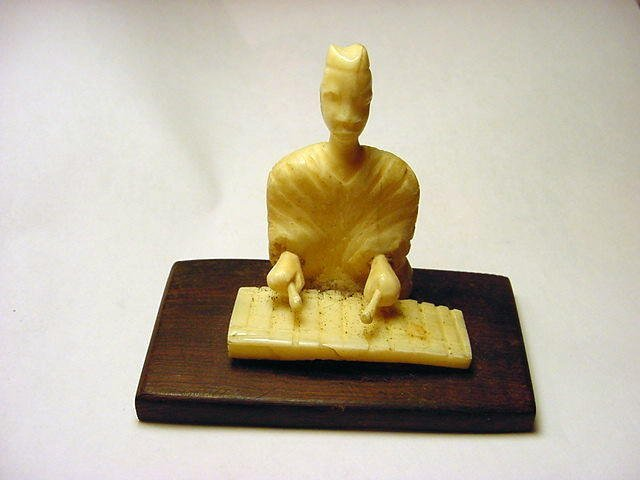 21: AFRICAN CARVED IVORY STATUE
