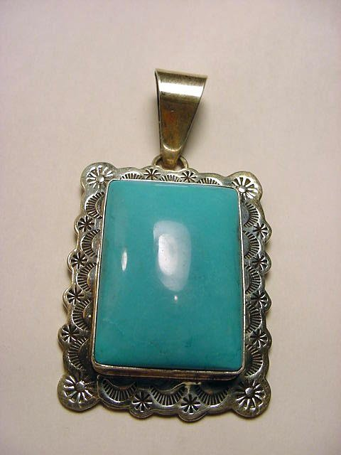 22: NAVAJO STERLING TURQUOISE PENDANT 1.5 X 2.75 INCHES