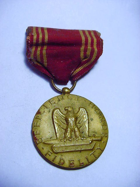 WWII GOOD CONDUCT MEDAL NAMED