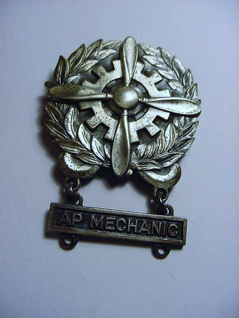 WWII AP MECHANIC STERLING BADGE