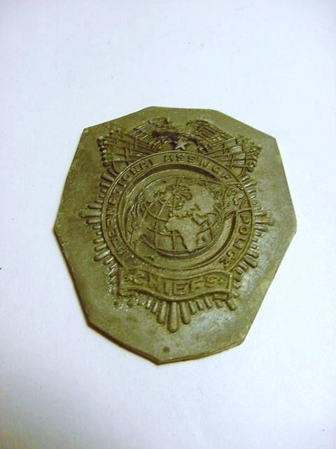 INT. ASSOC. OF POLICE CHIEFS BADGE DIE TRIAL BY THOMAS