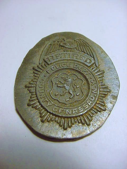 RETIRED NASSAU COUNTY POLICE BADGE DIE TRIAL BY THOMAS