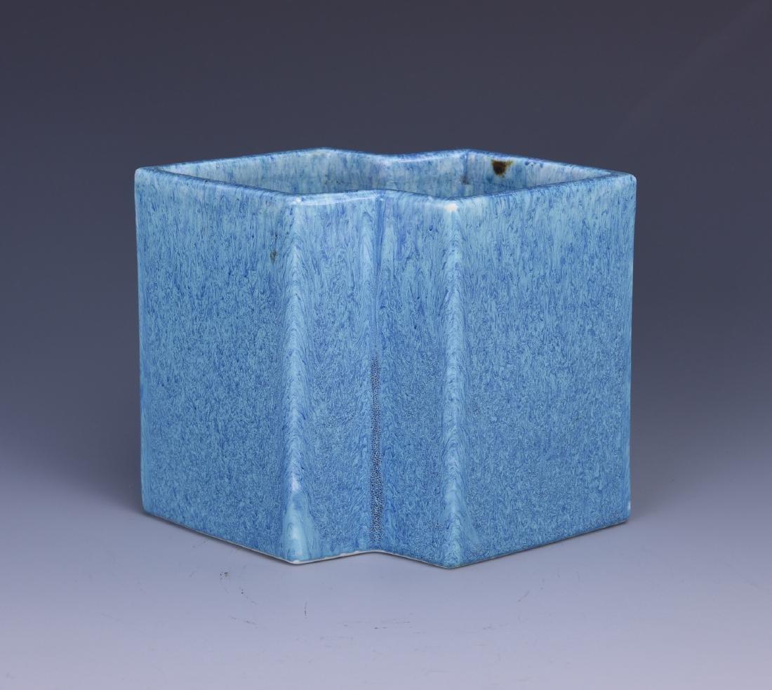 A FLAMBE-GLAZED DUAL-LOZENGE PORCELAIN BRUSH POT