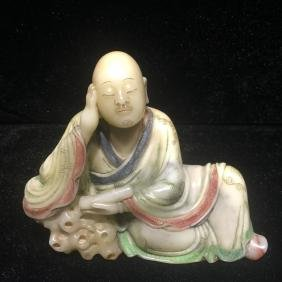 A SOAPSTONE SCULPTURE OF ROHAN