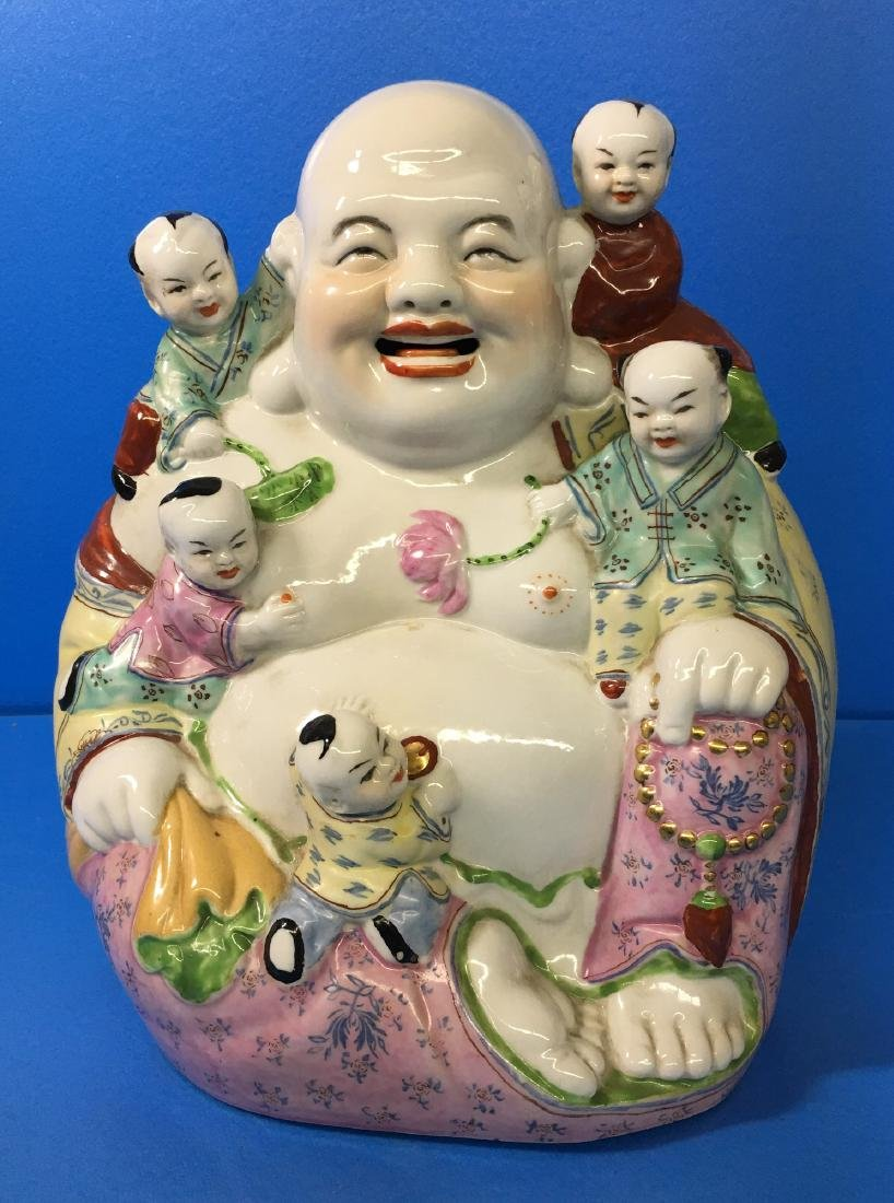 A FAMILY ROSE PORCELAIN YOUNG MAITREYA BUDDHA