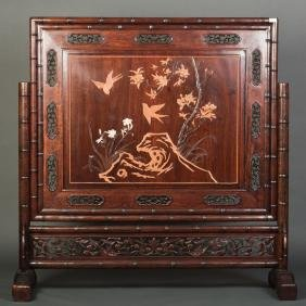 A BAMBOO-CARVED SCREEN
