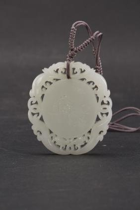 A Chinese carved white jade pendant