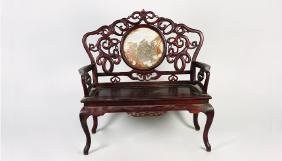 A ROSEWOOD ARMCHAIR WITH INTERWINED CARVING