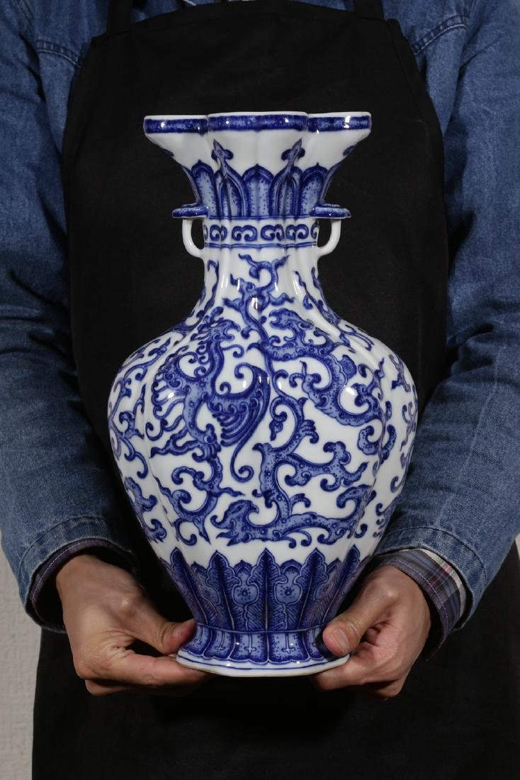 AN UNUSUAL BLUE AND WHITE PHOENIX FOILAGE VASE - 10