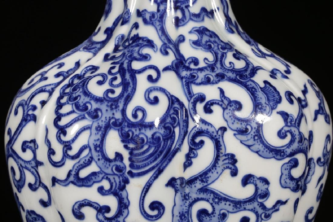 AN UNUSUAL BLUE AND WHITE PHOENIX FOILAGE VASE - 4