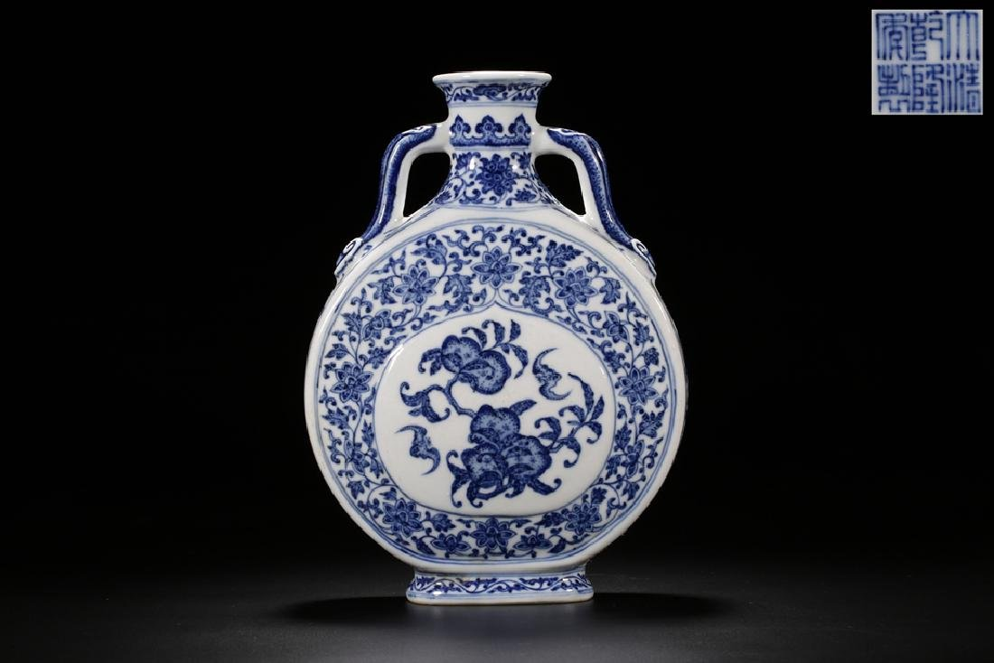 A MING-STYLE BLUE AND WHITE MOON FLASK