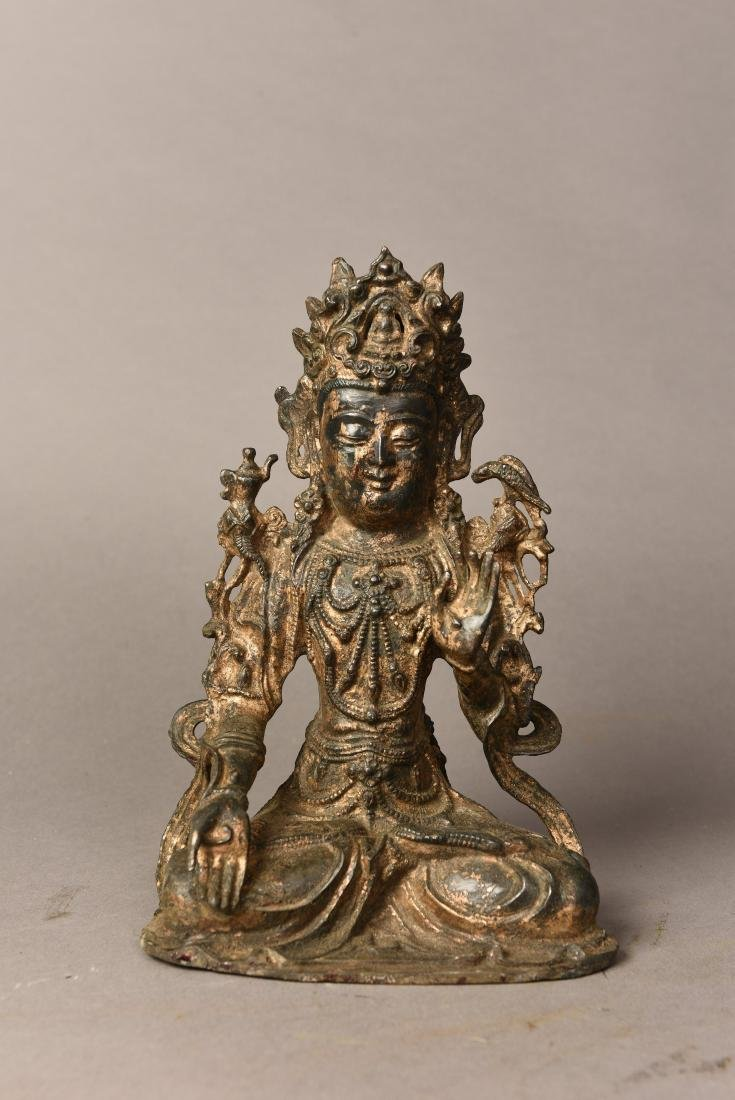 A BRONZE BUDDHA SCULPTURE