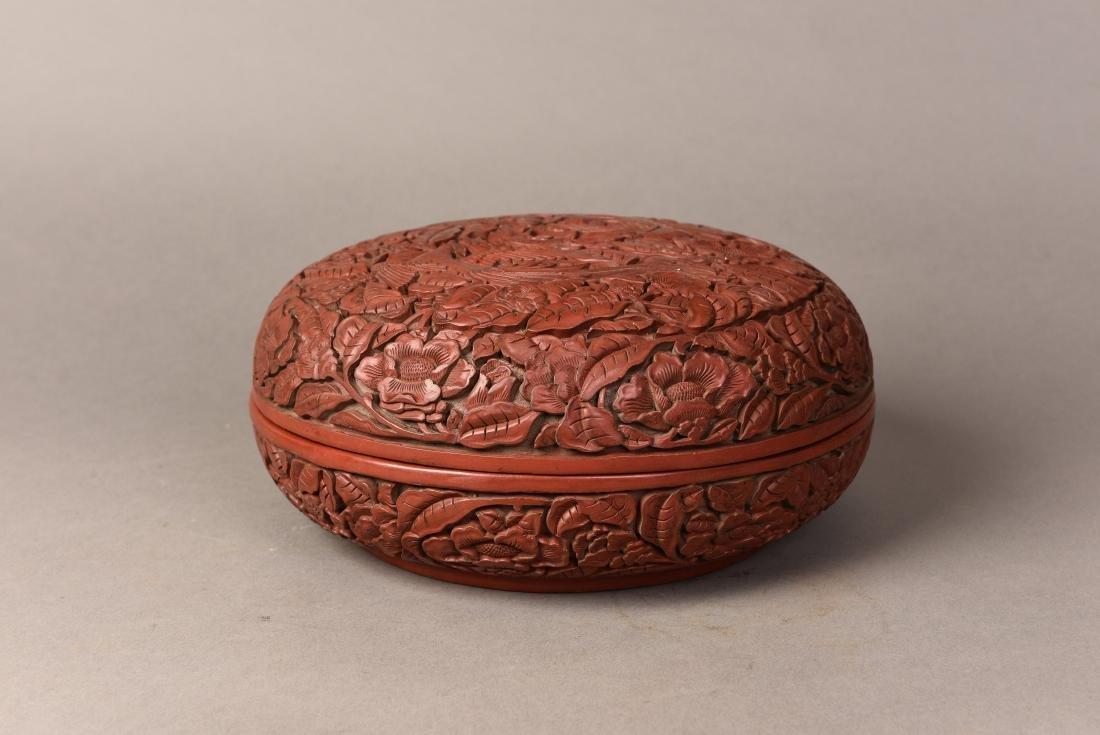 A CHINESE RED LACQUER CINNABAR BOX AND COVER
