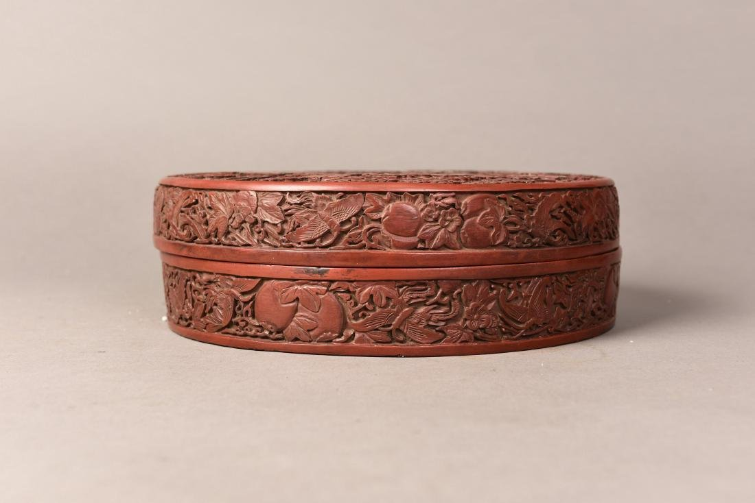 A RED LACQUER ROUND BOX AND COVER
