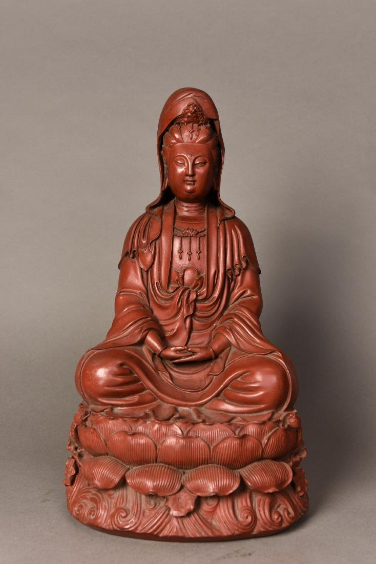 A RED LACQUER GUANYIN STATUE
