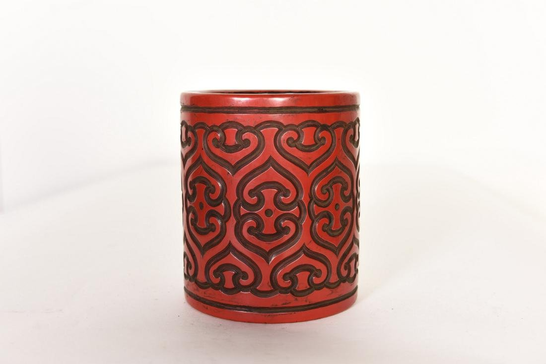 A CHINESE RED LACQUER BRUSH POT