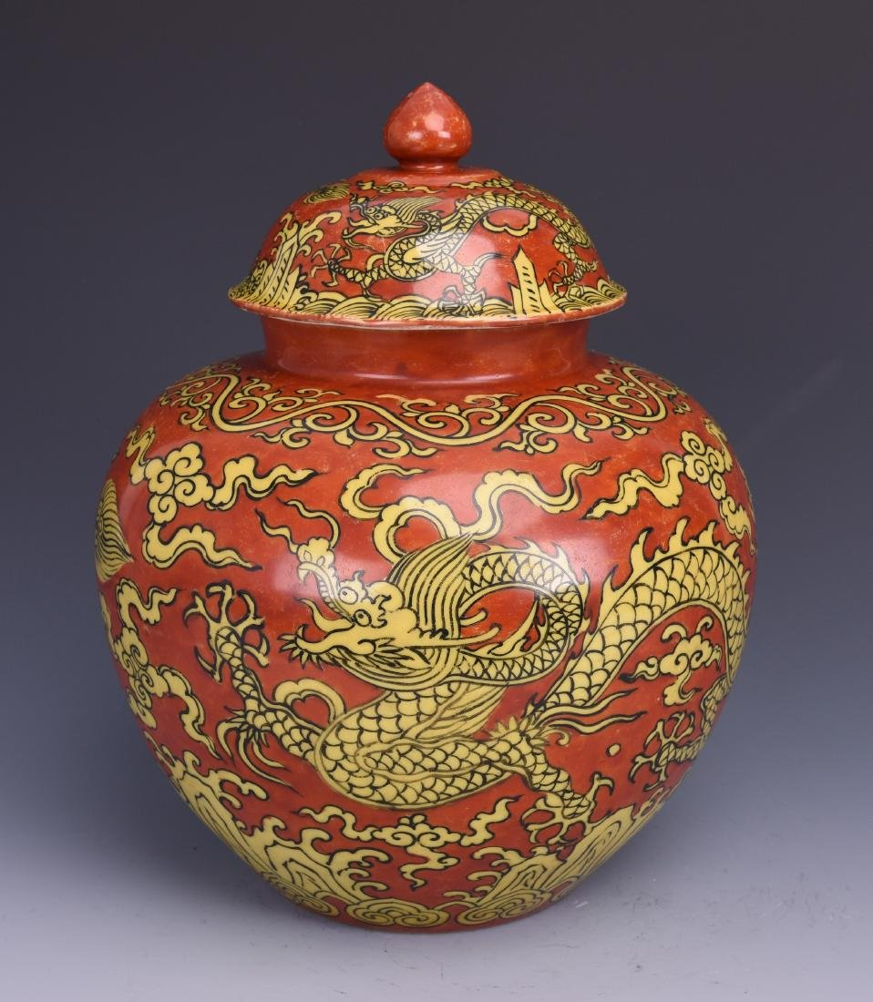 A CORAL-GROUND DRAGON JAR WITH COVER