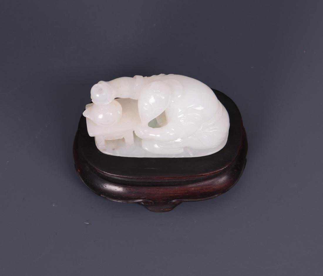 A WHITE JADE CARVING OF FIGURE