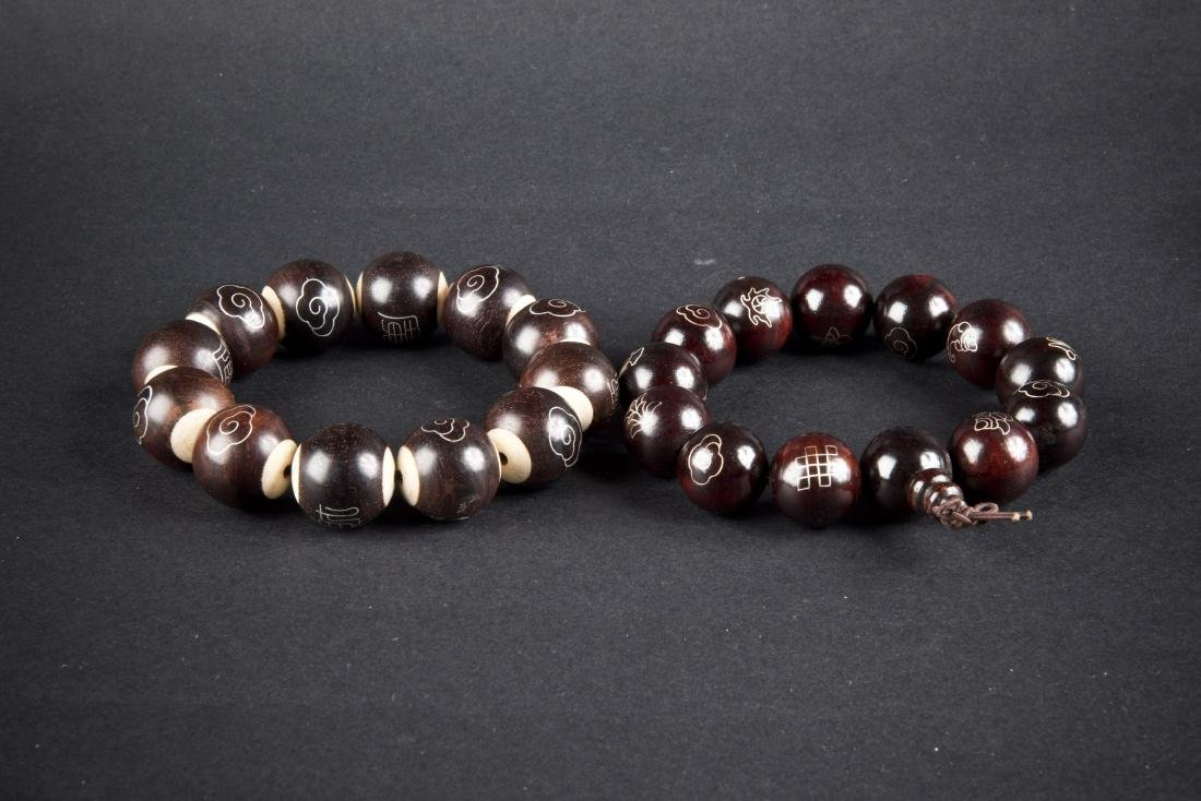 TWO WOOD-BEAD BRACELETS