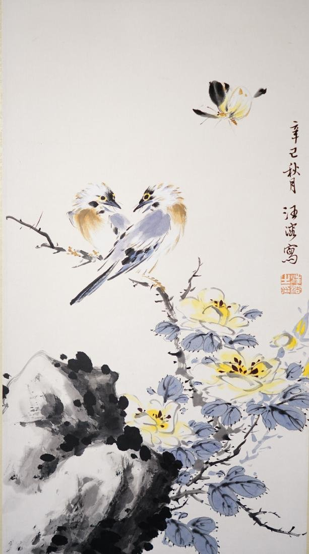 A CHINESE SCROLL PAINTING OF BIRDS AND FLOWER