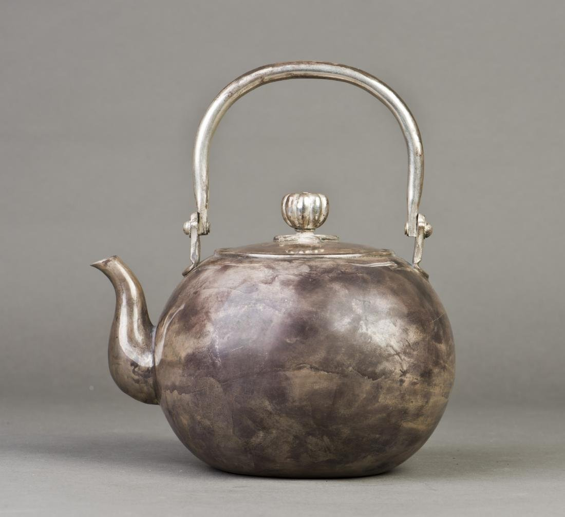 A ROUNDED JAPANESE SILVER TEAPOT