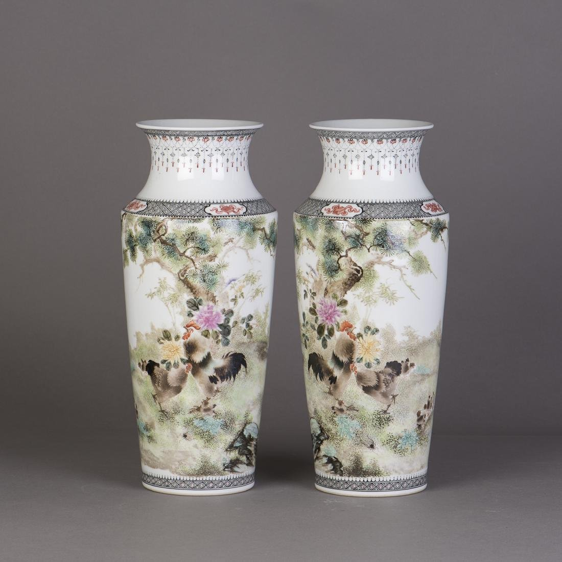 A PAIR OF FAMILLE ROSE PORCELAIN VASES