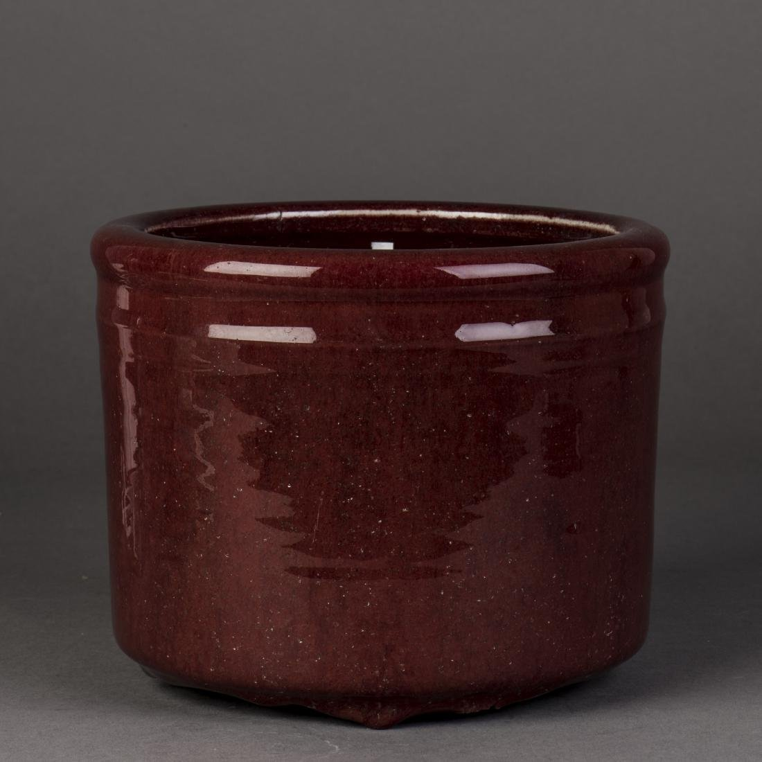 A CHINESE COPPER RED GLAZED BRUSH POT