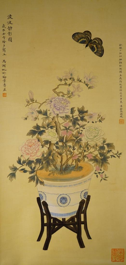 A CHINESE SCROLL PAINTING OF BUTTERFLY AND FLOWERS