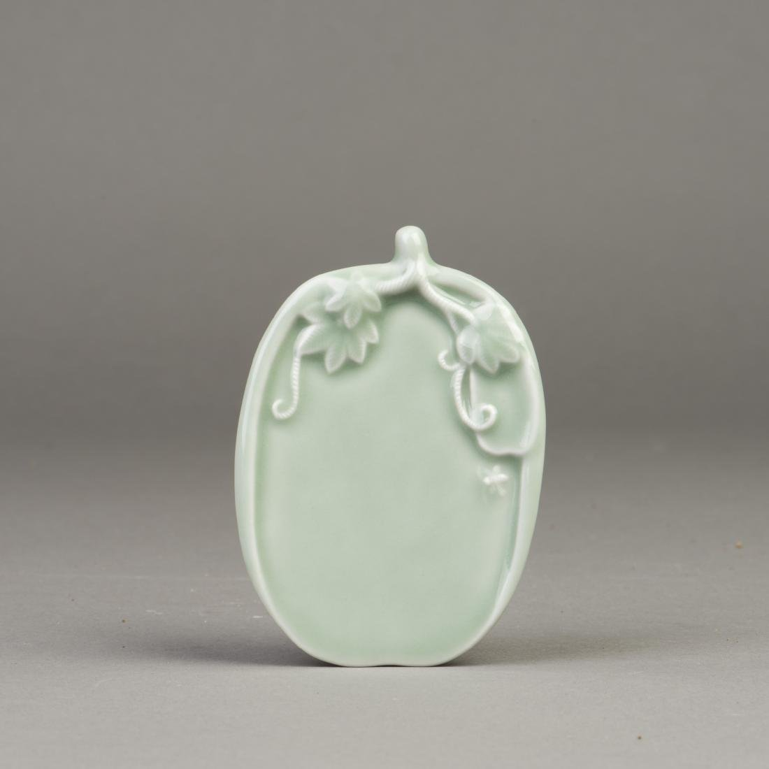 A CELADON PLATE IN LEAF FORM