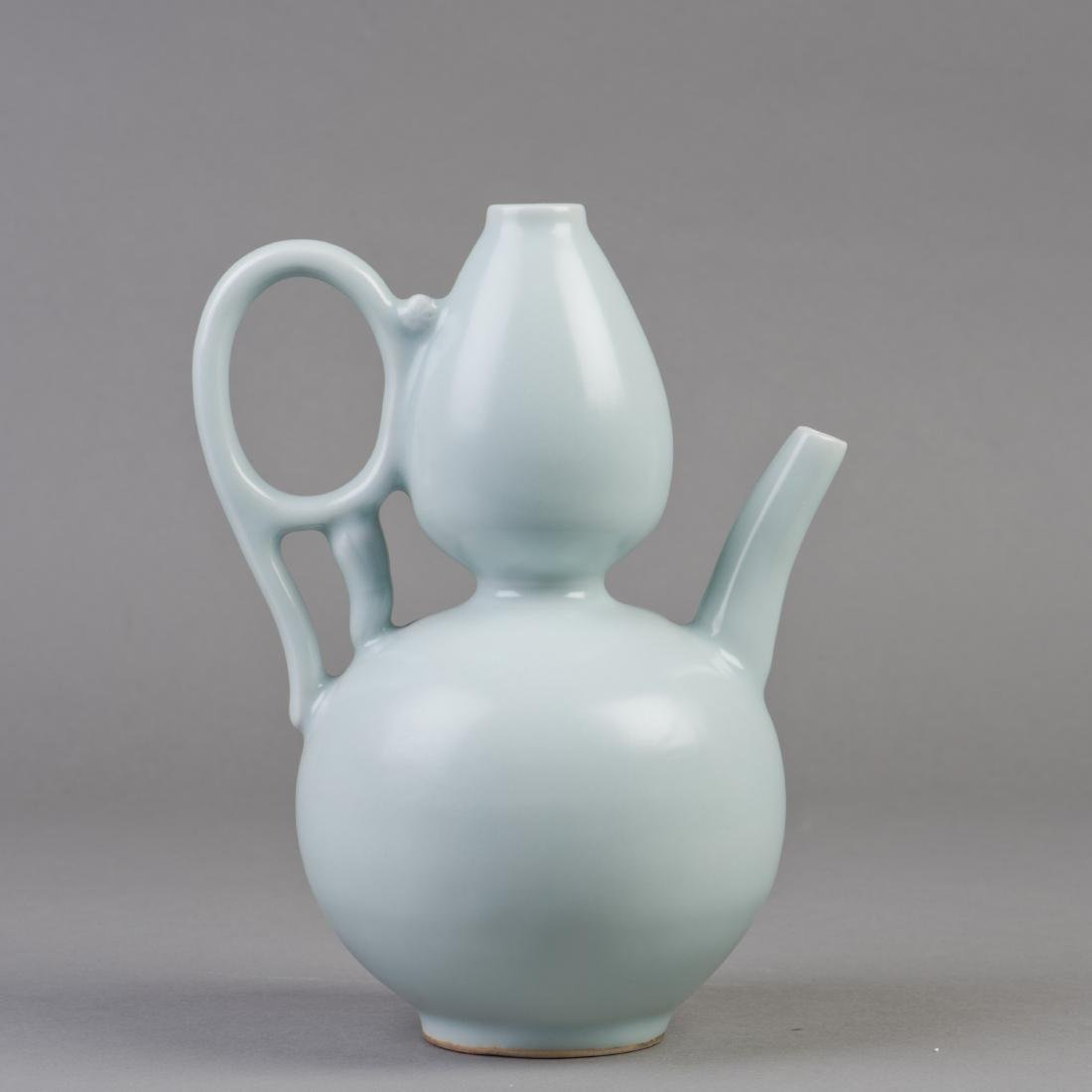 A CHINESE GOURD-SHAPED CELADON PORCELAIN VASE