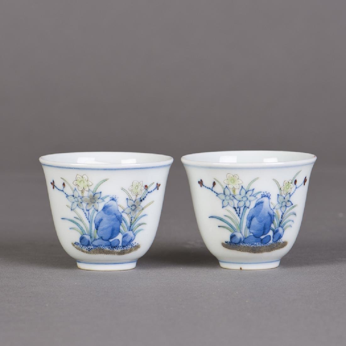 A PAIR OF SMALL CHINESE DOUCAI PORCELAIN CUPS
