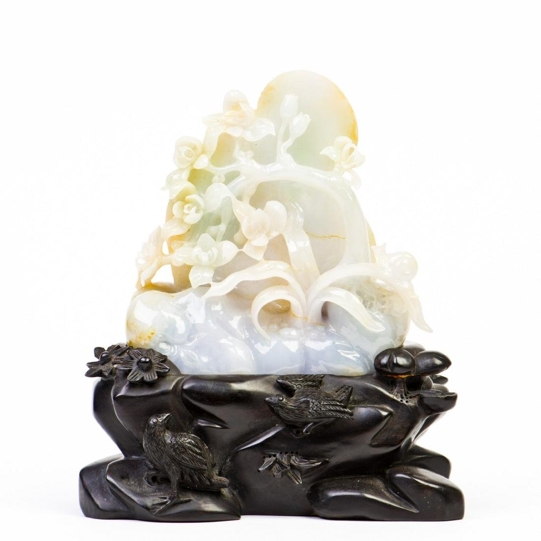 A CARVED 'FLOWER' JADE WITH STAND
