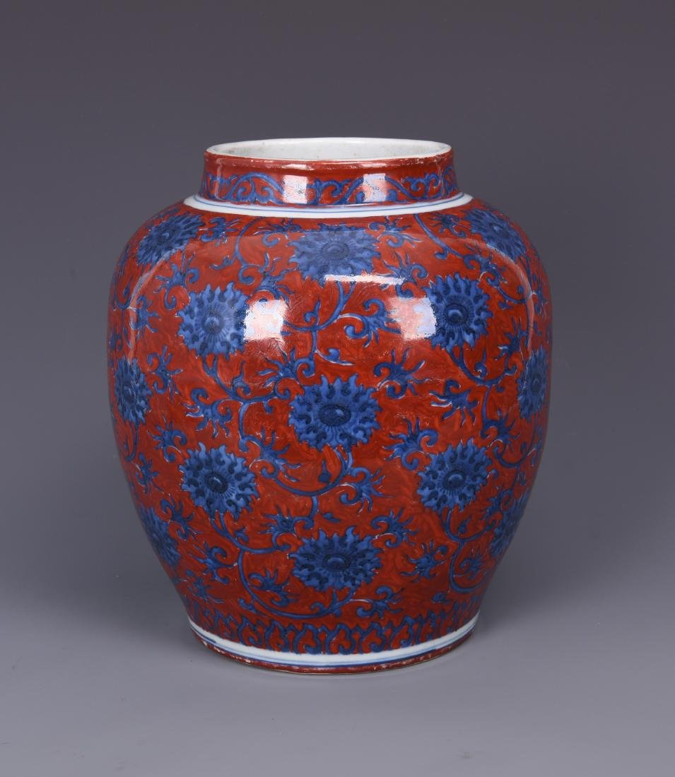 A COPPER RED GROUND BLUE AND WHITE PORCELAIN JAR