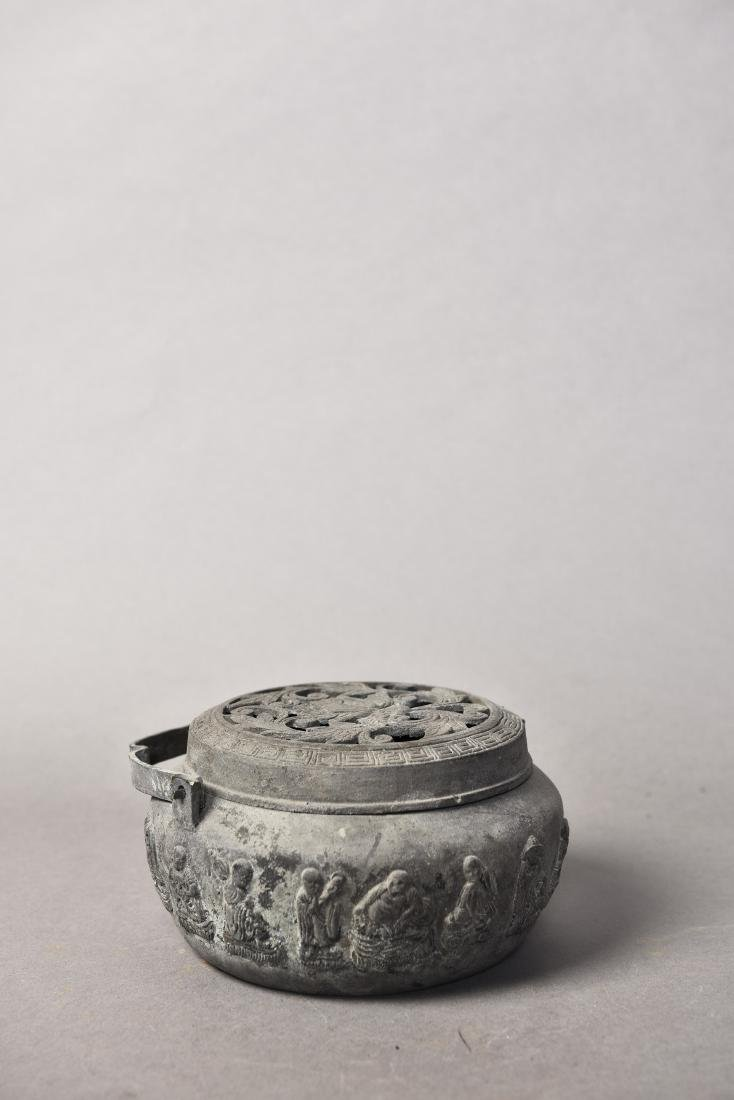 A BRONZE CENSER WITH COVER