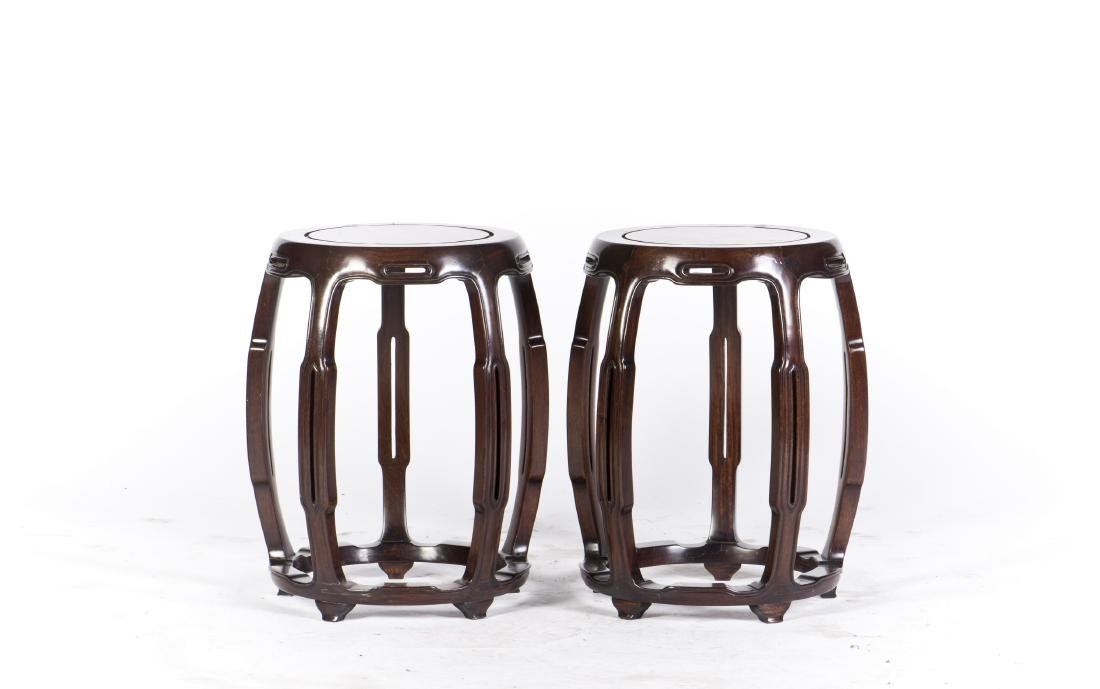 A PAIR OF HARDWOOD STOOLS