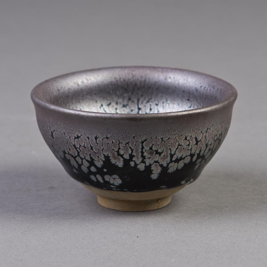 A BLACK GLAZED PROCELAIN BOWL