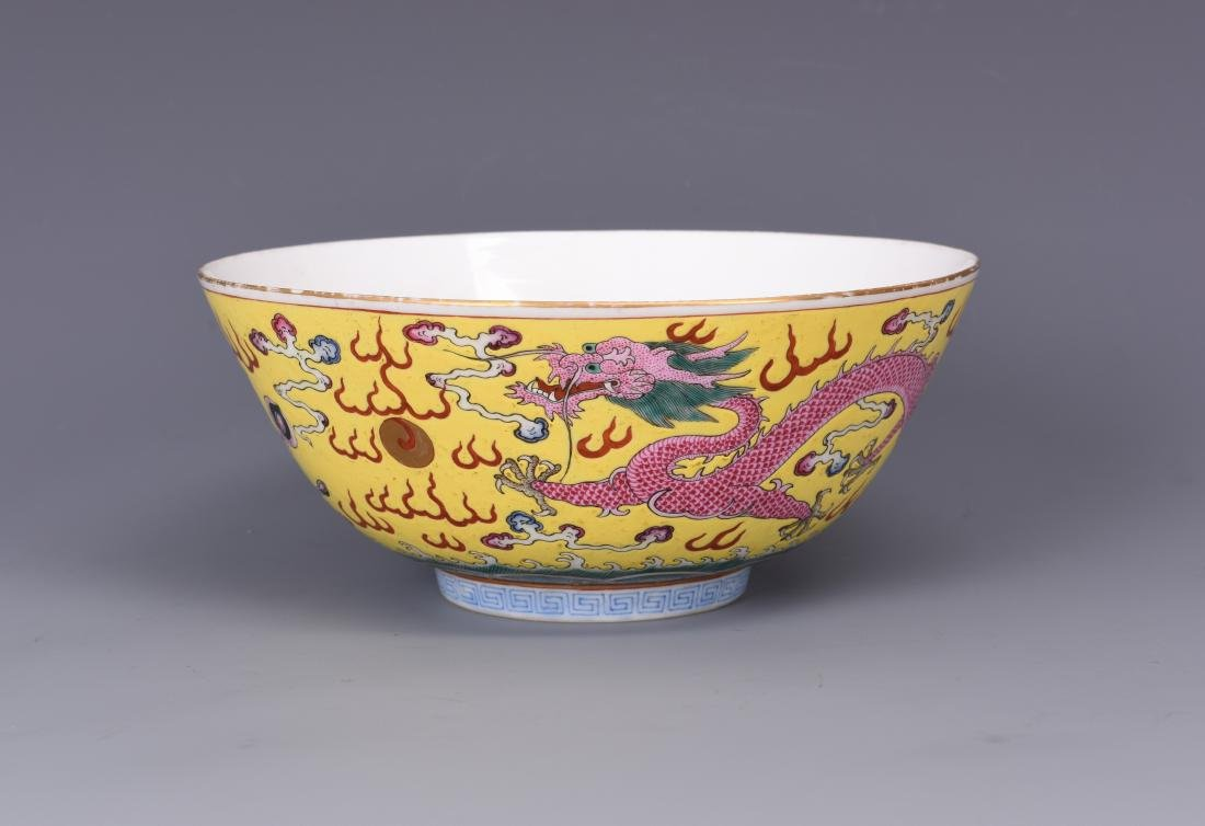 A FAMILLE ROSE YELLOW GROUND DRAGON BOWL