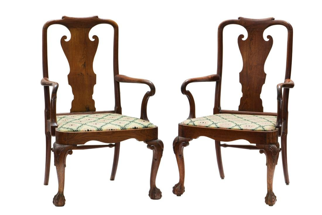 A PAIR OF CHIPPENDALE CARVED HARDWOOD ARMCHAIRS
