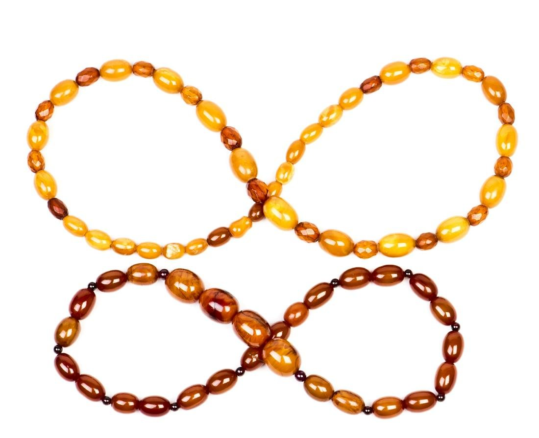 TWO STRANDS OF SMALL BEADED BEESWAX NECKLACES