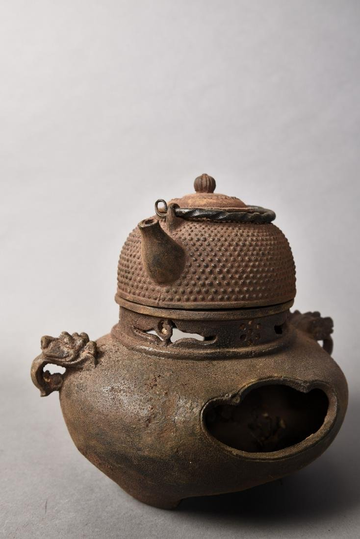 A IRON TEAPOT WITH A STOVE - 3