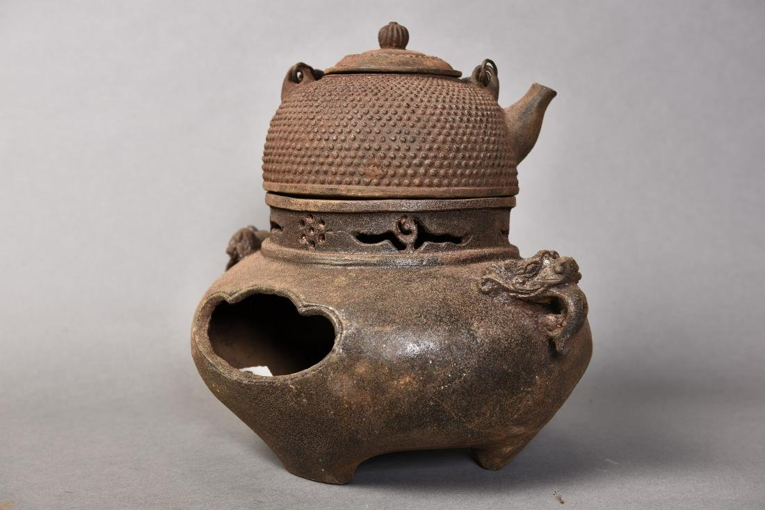 A IRON TEAPOT WITH A STOVE - 4