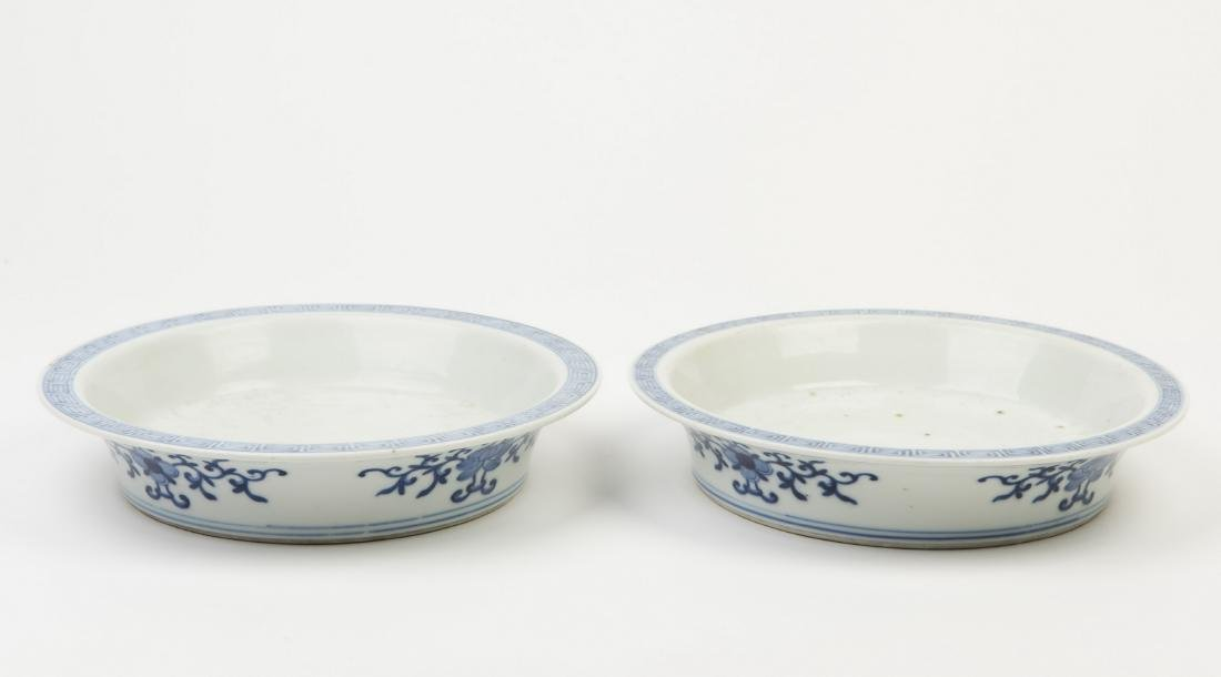 A SET OF TWO CERAMIC FLOWER BASES