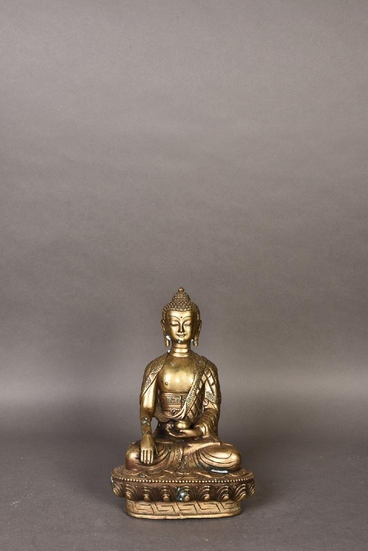 A GILT BRONZE SCULPTURE OF BUDDHA