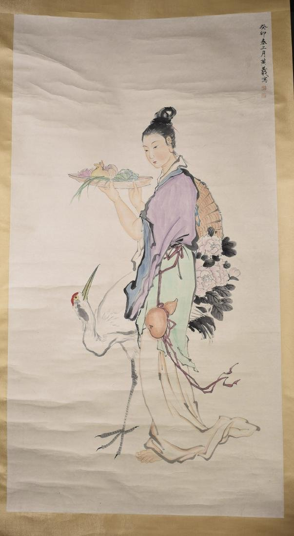 A CHINESE SCROLL PAINTING OF LADY