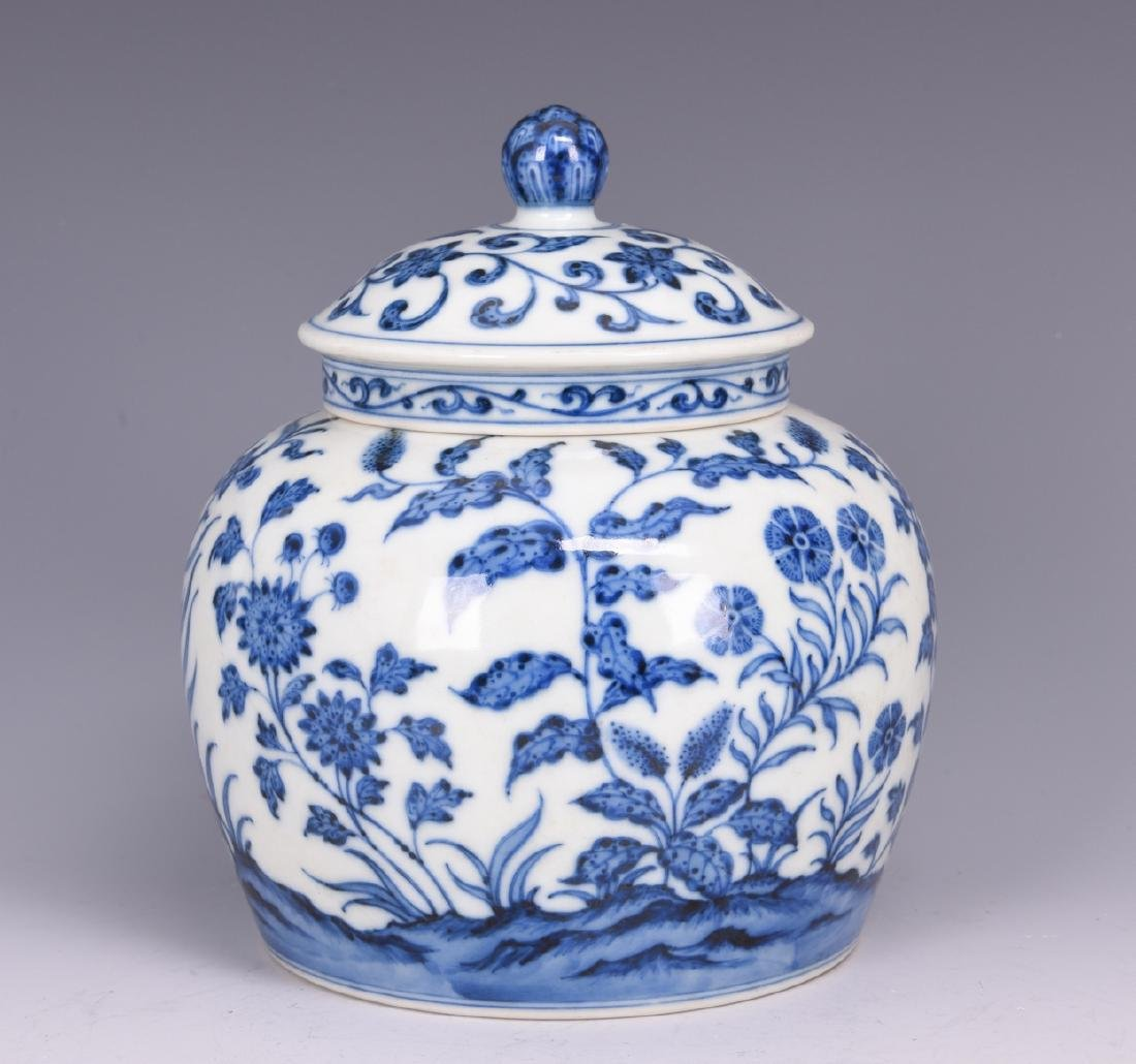 A BLUE AND WHITE 'LOTUS' PORCELAIN JAR WITH COVER