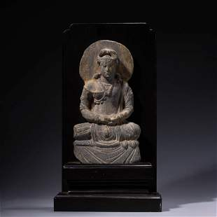 A CHINESE STONE CARVING OF GANDHARA STAUTE