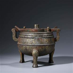A CHINESE BRONZE TRIPOT STEAMING VESSEL DING