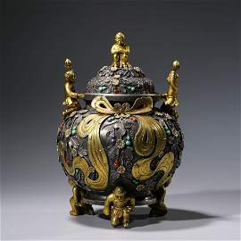 A CHINESE SIVER GILDING CHILD CENSER AND COVER