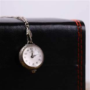 A Female Clock Pendant