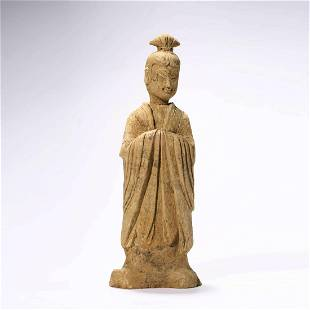 A Carved Pottery Figure Ornament